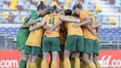 The Westfield Matildas make a huddle before last April's friendly against Brazil on home soil.