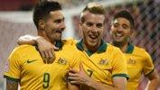 Jamie Maclaren celebrates after scoring Australia's second against Vietnam.