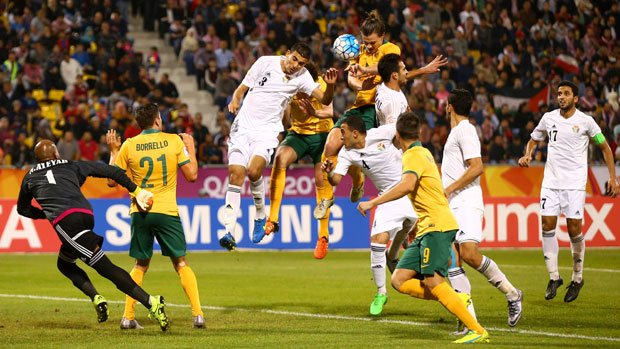The Olyroos go close to scoring from a set piece against Jordan.