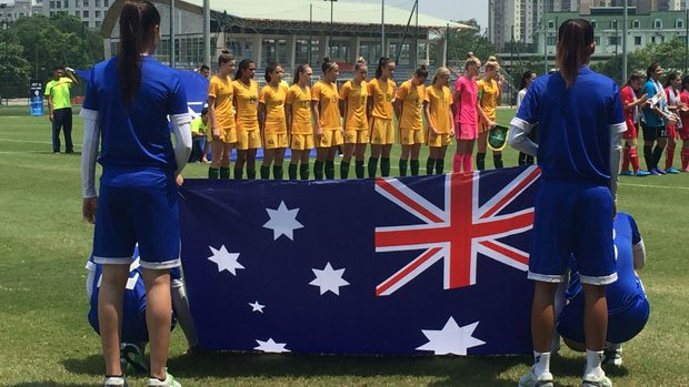 The Young Matildas sing the national anthem before their big win over Palestine.