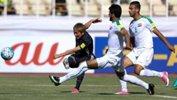 Genki Haraguchi tries a shot for Japan against Iraq.