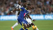 All Star Bernie Ibini and Juve's Paul Pogba jostle for the ball.