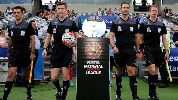 Match officials walk onto Central Coast Stadium for last season's FOXTEL NYL Grand Final.