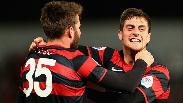 Juric and Antony Golec celebrate a goal in the Wanderers' 1-0 win over Guangzhou Evergrande.