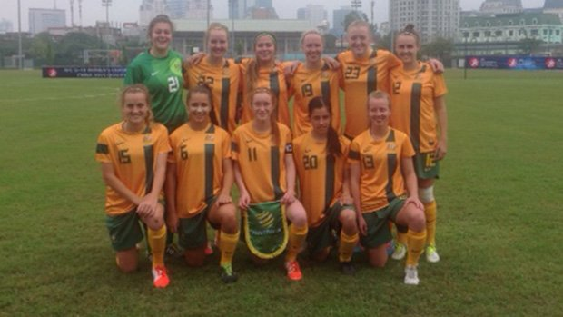 The Young Matildas pose for a team photo prior to their clash with Singapore.