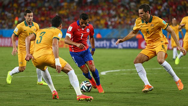 Alexis Sanchez in action against the Caltex Socceroos at the 2014 FIFA World Cup in Brazil.