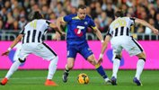 All Star striker Besart Berisha takes on two Juventus defenders.