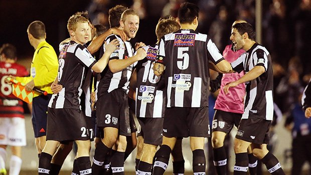 Adelaide City celebrate their decisive goal against Western Sydney.