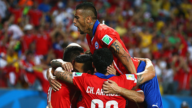 Arturo Vidal celebrates with his Chilean team-mates after a goal against Australia.