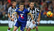 Besart Berisha challenges for the ball against Juventus at ANZ Stadium.