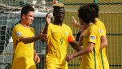 The Joeys celebrate John Roberts' goal against Uzbekistan on Sunday.
