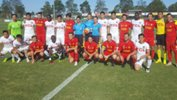 Broadmeadow Magic and Liaoning FC players pose for a team photo prior to kickoff. Image: BMagicFC Twitter