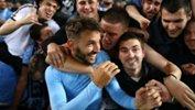 Milos Ninkovic is swamped by Sky Blues fans after full-time in the Sydney Derby.