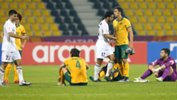 A disappointed Olyroos side shake hands with Jordan at full-time at the AFC U-23 Championship.