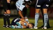 Sydney FC players check on the welfare of an injured Amy Harrison.
