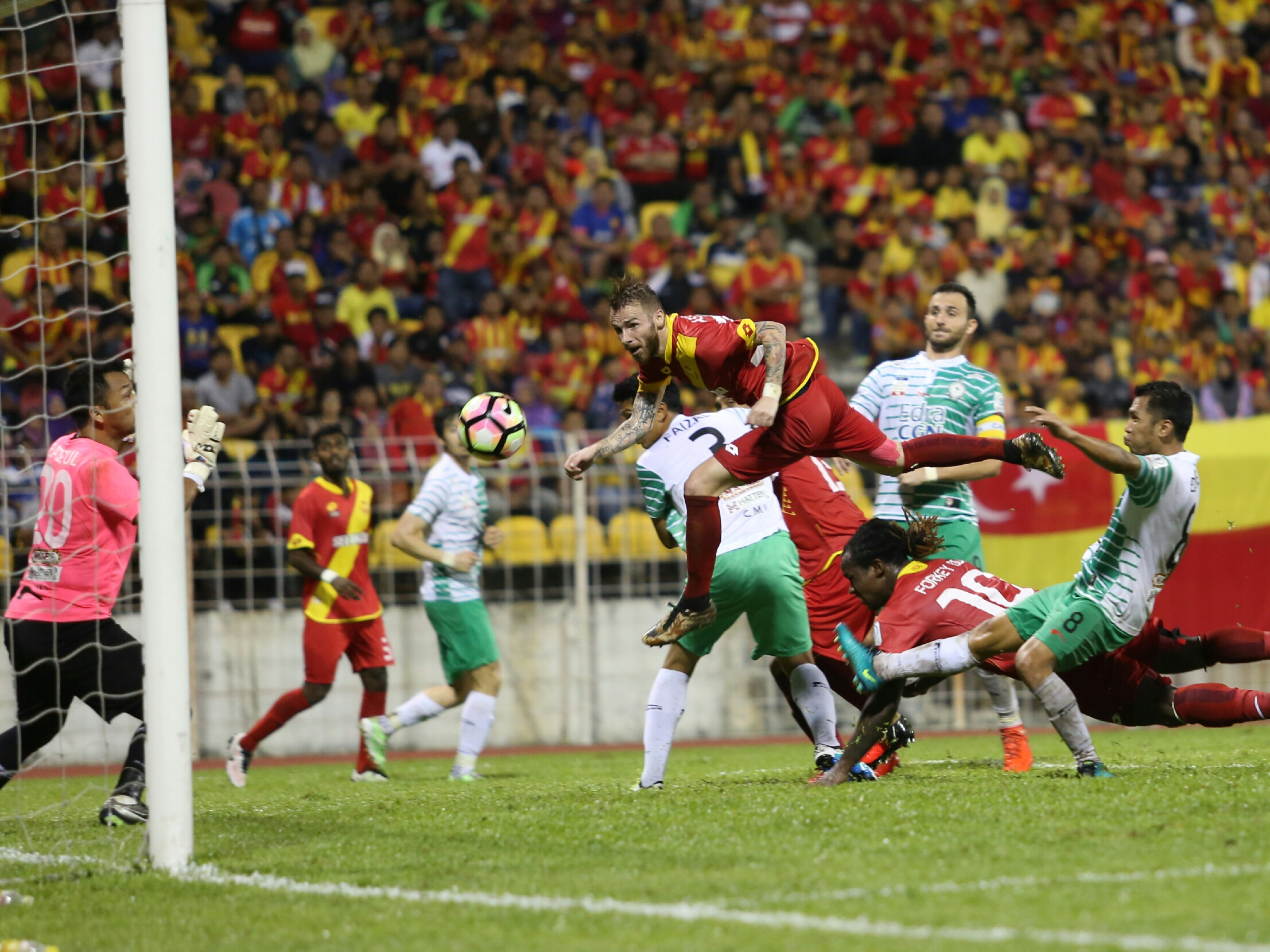 Selangor's Victor Astafei (in the air) heading in his team's equaliser against Melaka United 27/1/2017