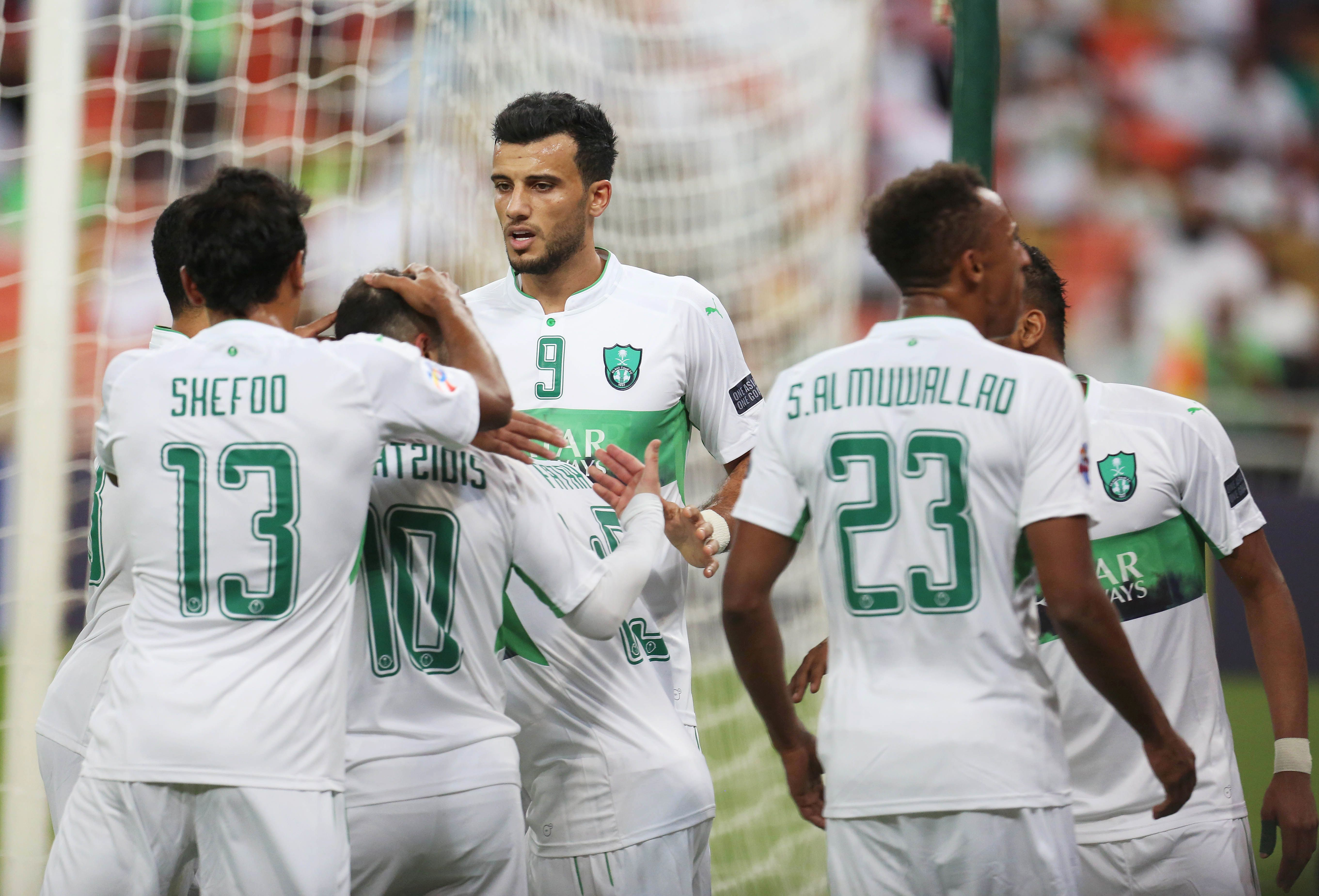 Saudi's Al-Ahli players celebrate after scoring during their AFC Champions League qualifying football match against Uzbekistan's Bunyodkor on February 21, 2017, at King Abdullah Sports city near Jeddah