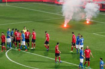 Italy-Albania suspended after fireworks thrown onto pitch