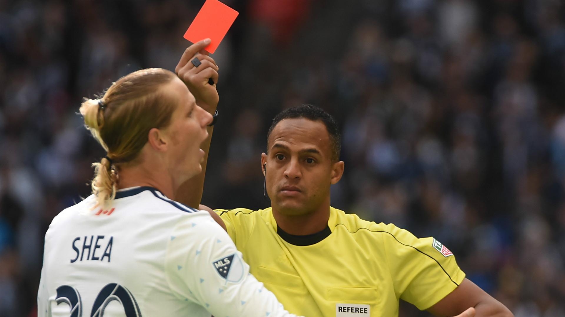 Referee Ismail Elfath; Brek Shea Vancouver Whitecaps