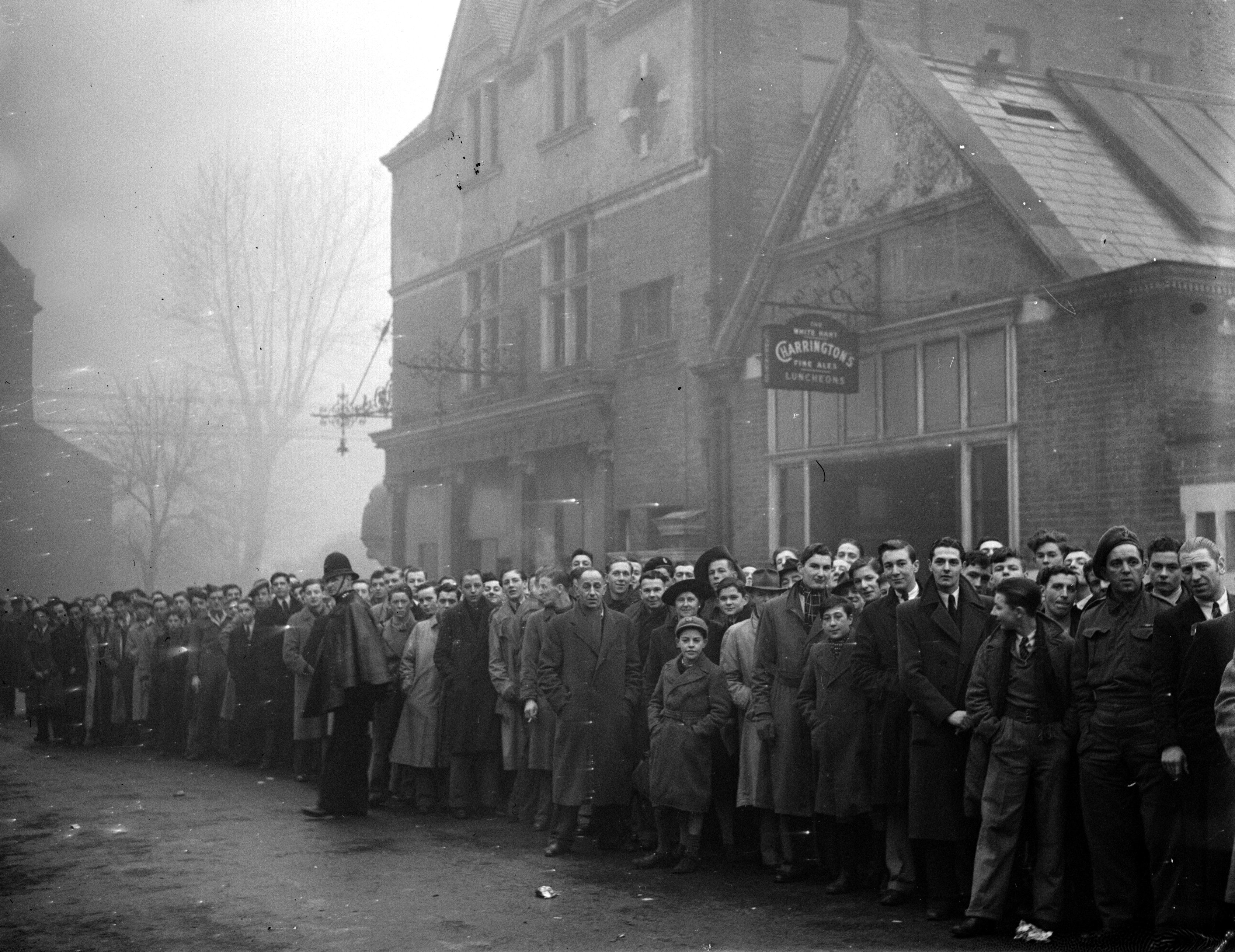 Fans queue outside White Hart Lane in 1945