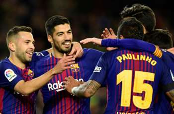 Suarez and Paulinho braces give Barcelona easy win over Deportivo