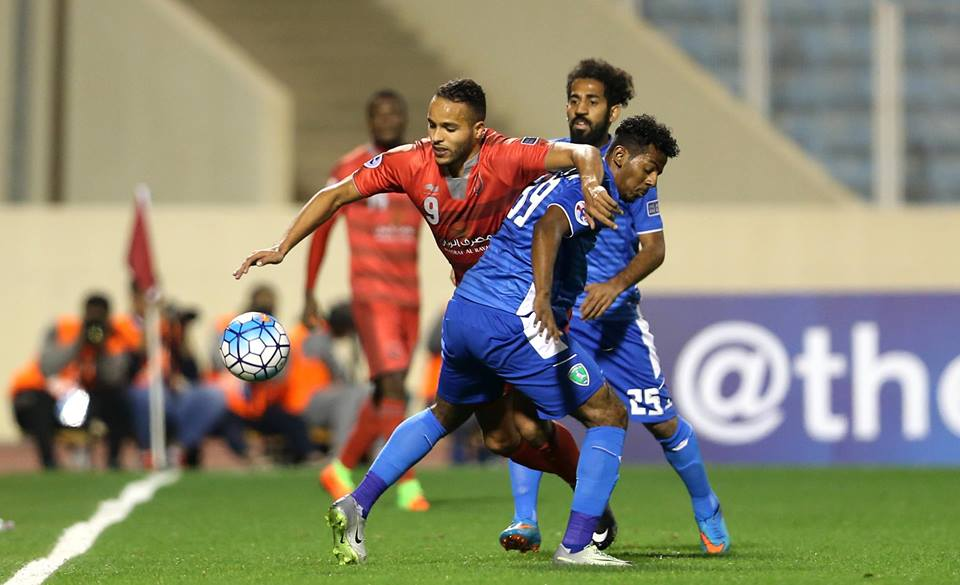 Lekhwiya's EL Arabi fighting for the ball