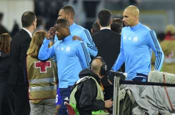 Evra shown red card for kicking fan as violence erupts before Marseille match