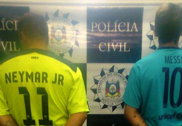 Incredible police photo shows Messi and Neymar fanboys being arrested in club shirts