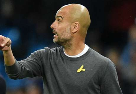 Guardiola charged for yellow ribbon