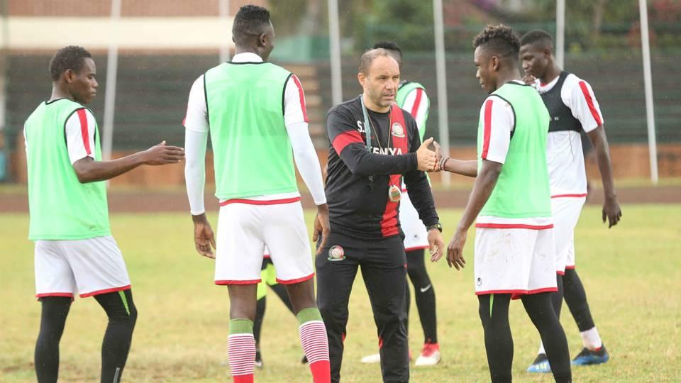 Aboud Omar and Harambee Stars coach Sebastien Migne.