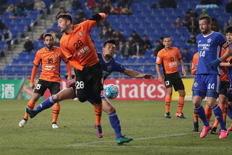 Brandon Borrello of Brisbane Roar and Lee Ki-Jae of Ulsan Hyundai FC compete for the ball