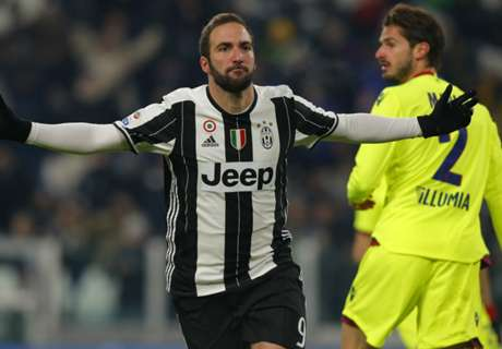 Higuain brace sinks beleagured Bologna