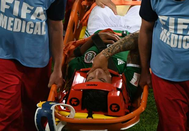 Mexico's Carlos Salcedo stretchered off against New Zealand