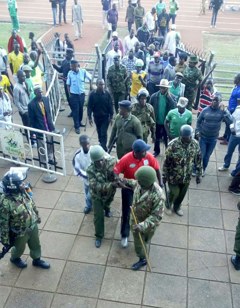 Muyoti being escorted at Nyayo Stadium