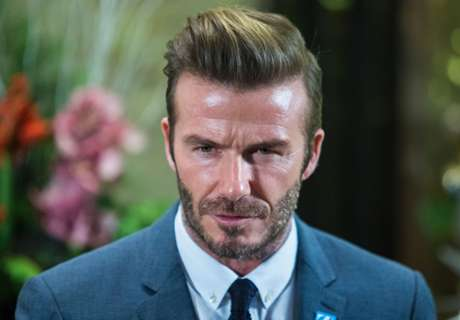 Beckham shows off expert flipping skills