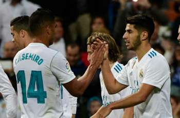 Madrid ease past Eibar to stay third