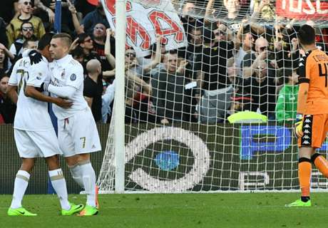 Bacca's controversial penalty lifts Milan