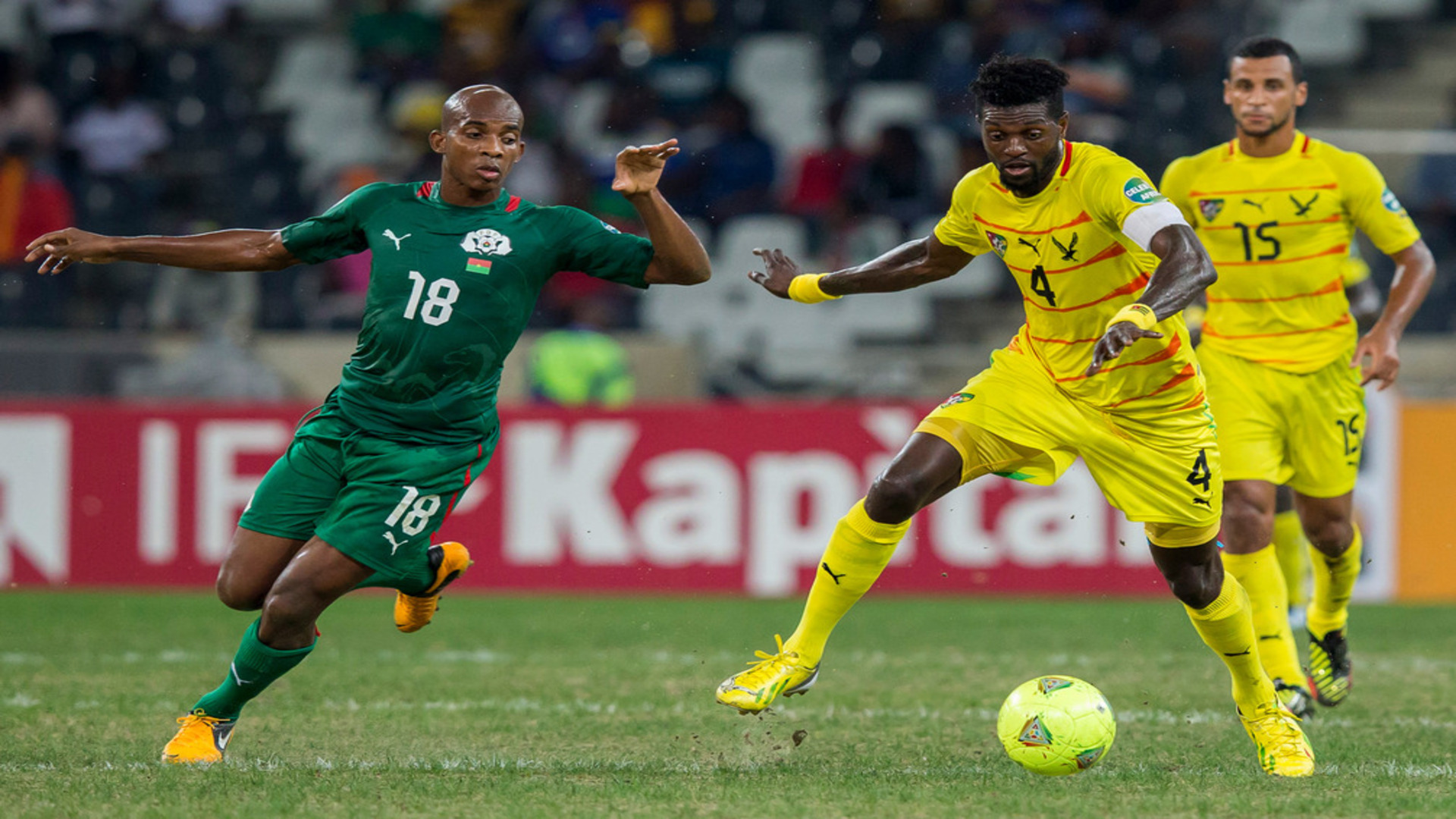 Charles Kabore of Burkina Faso and Emmanuel Adebayor of Togo