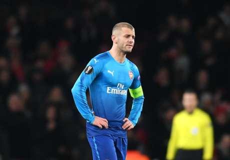 Wenger hits back at Keane's Wilshere rant