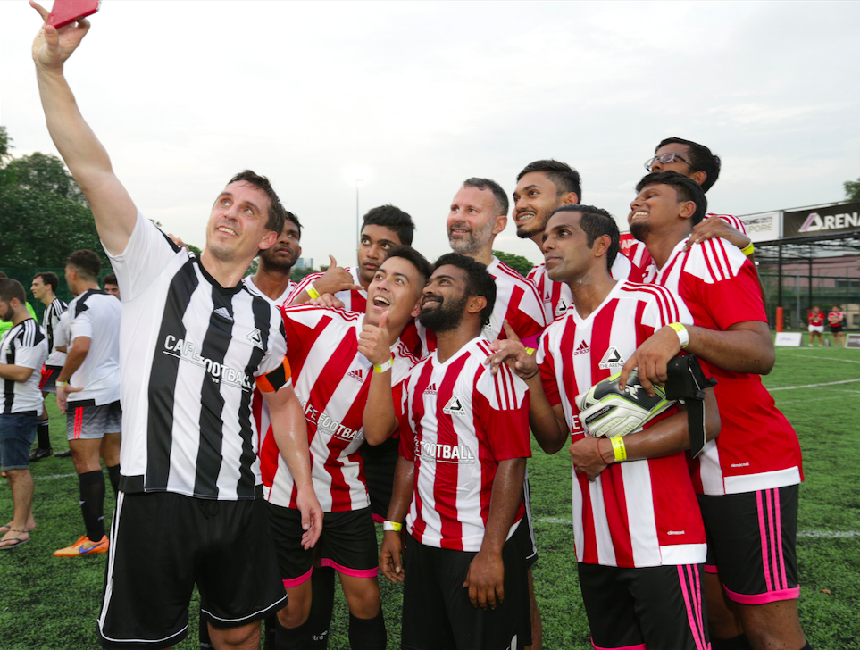Gary Neville celebrates with his team mates from ProFut5al during the CF  Cup Grand Final.