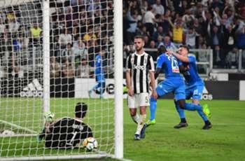 Title race on as Napoli stun Juventus late