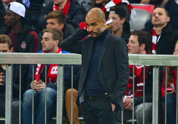 A downcast Guardiola during his team's defeat to Real Madrid.