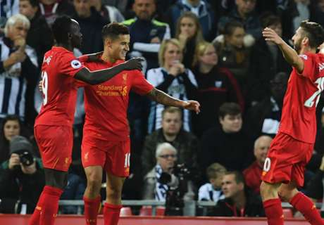 Liverpool down West Brom to go second