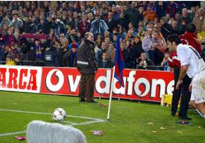 Luis Figo was the darling of Camp Nou but made the controversial move to Real Madrid in 2001. His return to Barcelona was terribly received as he was pelted with missiles from the crown, including a pig's head, pictured to the left of the corner flag