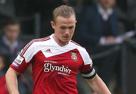Wrexham boss punches assistant