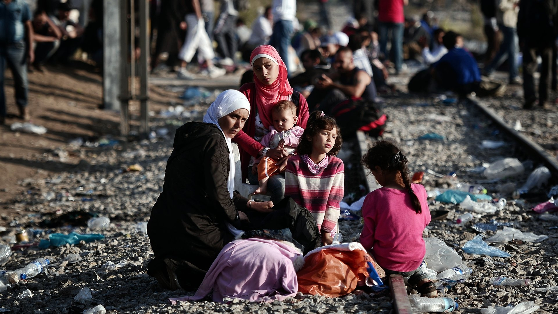 Syrian refugees on a train track