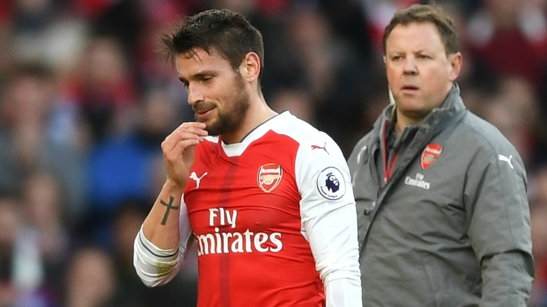 Gunners sweat over Debuchy injury