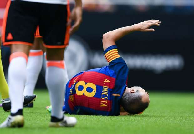 Iniesta in tears after being stretchered off