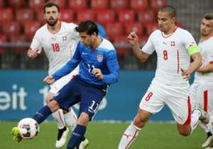Alejandro Bedoya controls the ball for the U.S. versus Goekhan Inler of Switzerland.