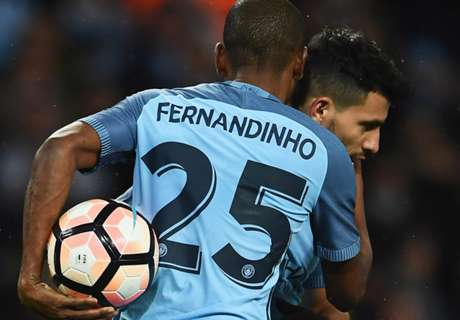 Aguero double sees City progress in Cup